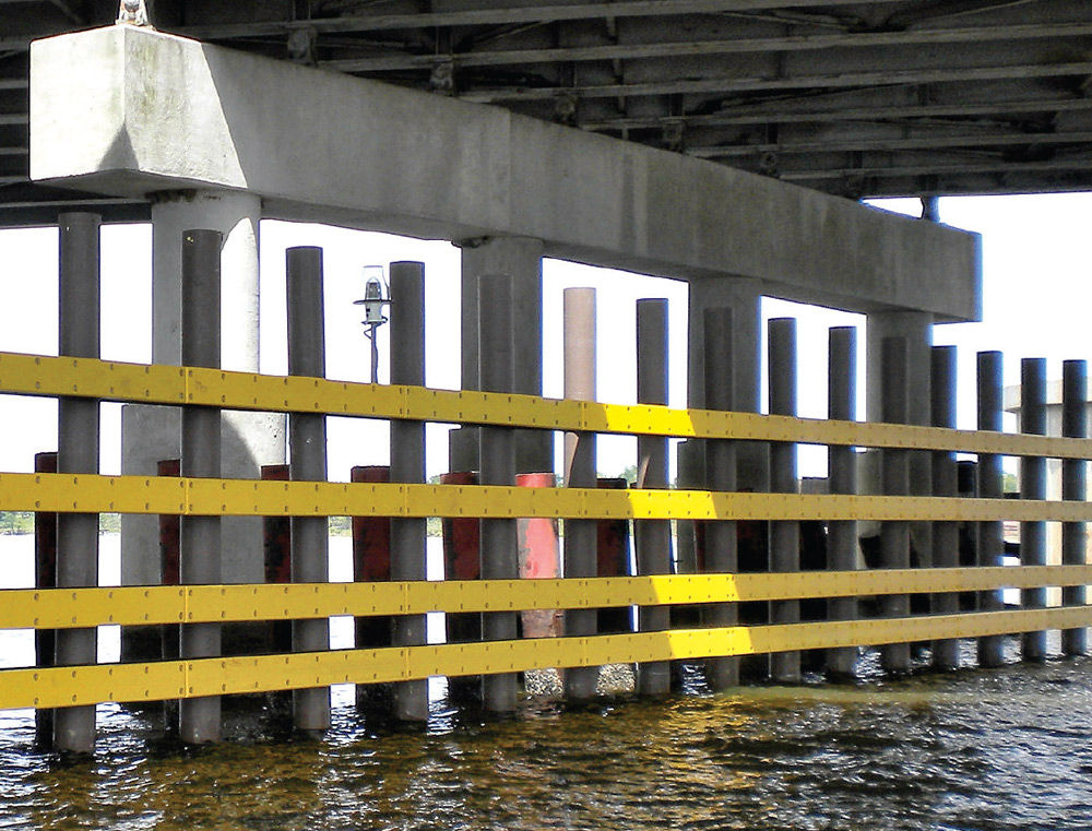 TX DOT Fendering with fiberglass pilings data-title=