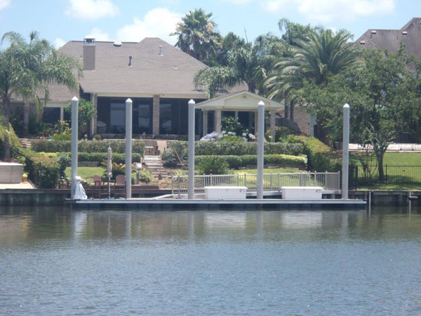 League City, TX floating dock with fiberglass pilings