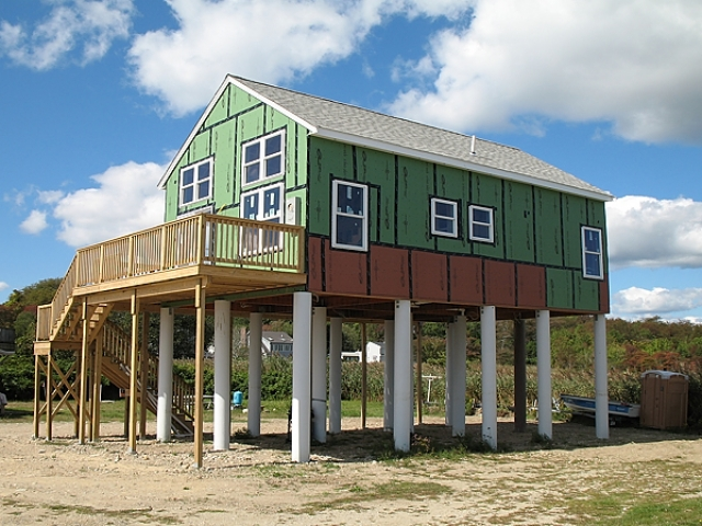 Mattapoiset, MA home on stilts | fiberglass pilings