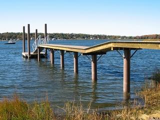 Monopile dock with fiberglass pilings