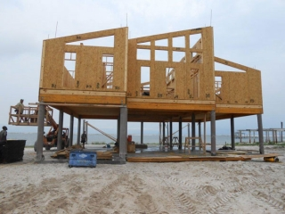 Home Being Built With Fibergl Pilings Foundation