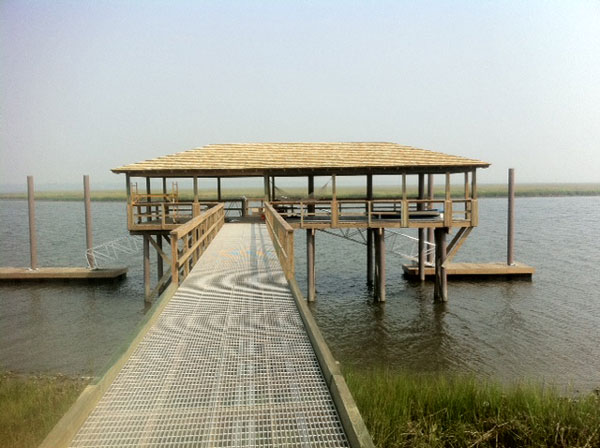 Flow through decking with composite pilings