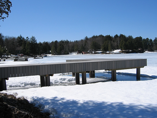 Dock in Adirondack, NY with fiberglass pilings hold up to snow and ice
