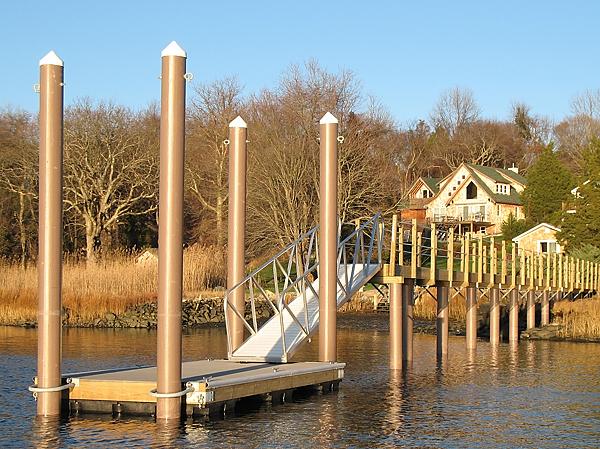 float dock with fiberglass pilings