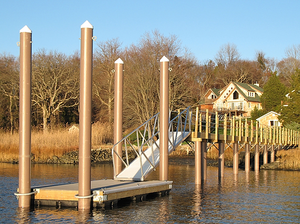 float dock with fiberglass pilings