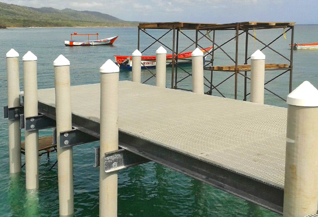 Dock made with composite pilings